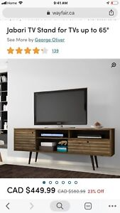 Tv stand 65inch new in the box..