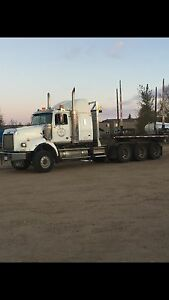 Truck and trailer ready to haul logs