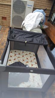 Portable infant cot
