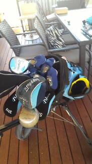 Set of ladies golf clubs with buggy