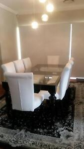 8 seater dining table with 8 white leather chairs