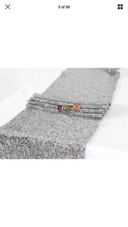 2 x silver sequin table runners.