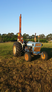 Tractor and post rammer