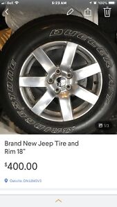 One brand new Jeep tire and rim