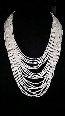 WHITE MANY STRAND SEED BEAD NECKLACE WITH ADJUSTABLE CLASP