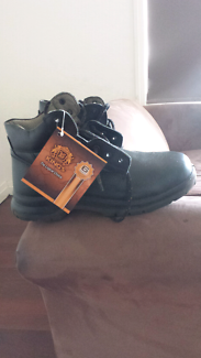 Size 12 steel cap work boots, never worn. Brand new