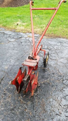 "Tiller frame with 12"" Tines with tiller engagement and choke, throttle cables"