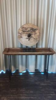Unique console or hall table with wooden wheel sculpture.