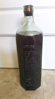 Old E.Rowlands embossed glass bottle