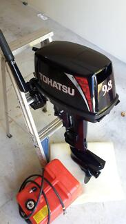 Tohatsu 9.8HP two-stroke outboard motor in brand new condition