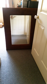 Large mirror with brown velvet