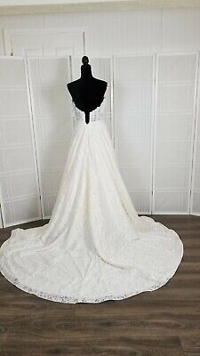 Wedding gown color ivory size 10 lace over organza  Paloma blanca