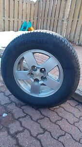 235/65r/16 Continental All season tires and rims