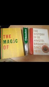 Heineken draft beer handle and books