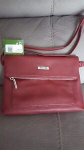 Roots crossbody bag! Never used.
