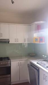 Lovely kitchen with white cabinets and stone surface benchtops Heidelberg Heights Banyule Area Preview