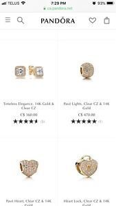 Gold pandora charms and bracelet