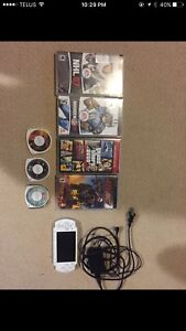 Psp with charger and games