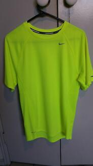 Nike Dri-Fit yellow tennis shirt in adult small size