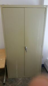 7' tall metal cabinet. I can deliver