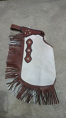 M hair-on chinks/chaps w/texas star conchos, fringe, basket stamp yoke