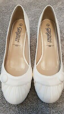 Ladies white, kitten heel court shoes