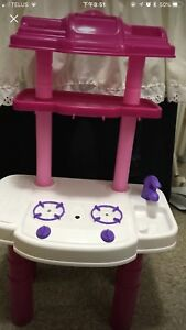 Toddler's pink and white plastic kitchen table