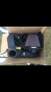 Air raid intake and throttle body spacer