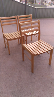 3 pine timber dining chairs.