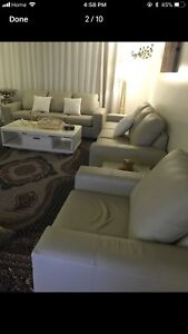 Sofa set 100 %  Leather 3 pieces and 2 coffee table .