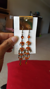 Long orange earrings Baulkham Hills The Hills District Preview