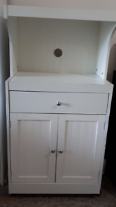 Microwave stand with drawer and cabinet.  White