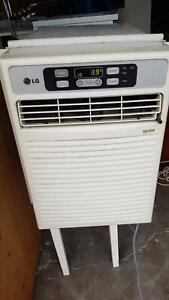 PAIR OF LG. GOLD AIR CONDITIONERS- PLUG IN AND USE - CAN SEE WORKING