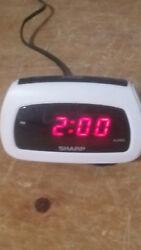 small alarm clock by sharp