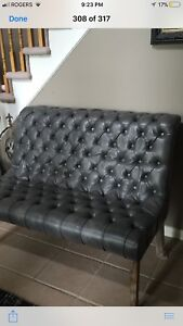 Beautiful grey leather tufted bench, wooden legs.