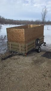 Factory 4x8' tilt trailer with 2 new spares.