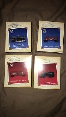 Hallmark set of 4 Lionel train set ornaments 2005 dated. New