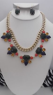 Clip on gold chain link statement necklace & earrings w/grn multi colored stones