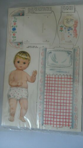 TINY TEARS DOLL AND CRADLE.  NO CLOTHES   NOT PUNCH OUT OF CARDBOARD.    NO BOX.
