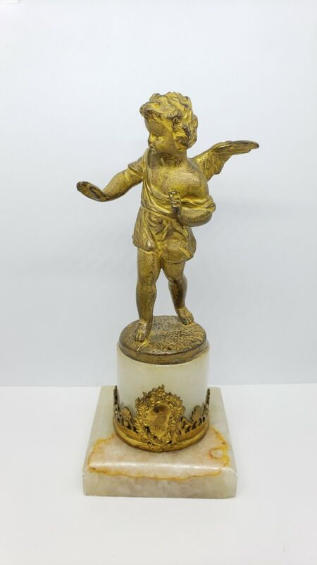 Antique bronze putti angel on marble base statue