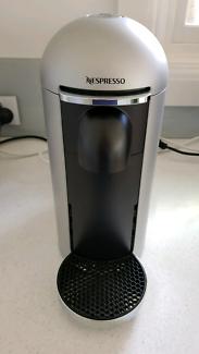 Nespresso Vertuo Vertuoplus in silver round top