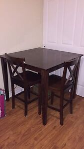 Pub style tall table with two chairs