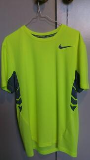 Nike Dri-Fit running shirt in adult medium size