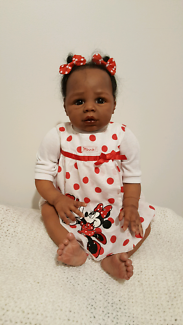 Lifelike ethnic Reborn baby doll- approx 24 inches