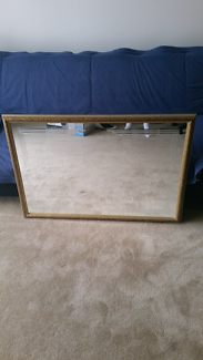 Mirror with black and gold frame