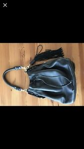 Genuine leather bucket purse with tassel and hardware