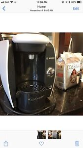 Tassimo Coffee Maker with lots of coffee pods included