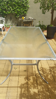 Outdoor glass top table