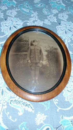 ANTIQUE HISTORIC WWI  SOLDIER/BOY PHOTO  OVAL GLASS BUBBLE FRAME