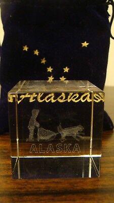 (Alaska Glacier Crystal Souvenir Inside Man With Dogs Sled With Blue Velvet Bag)
